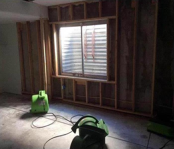 room of house with SERVPRO drying equipment at work