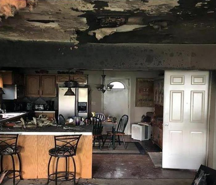 kitchen and living room covered in soot by fire